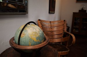 a wooden chair and a globe.
