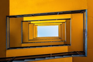 image of a yellow staircase from below